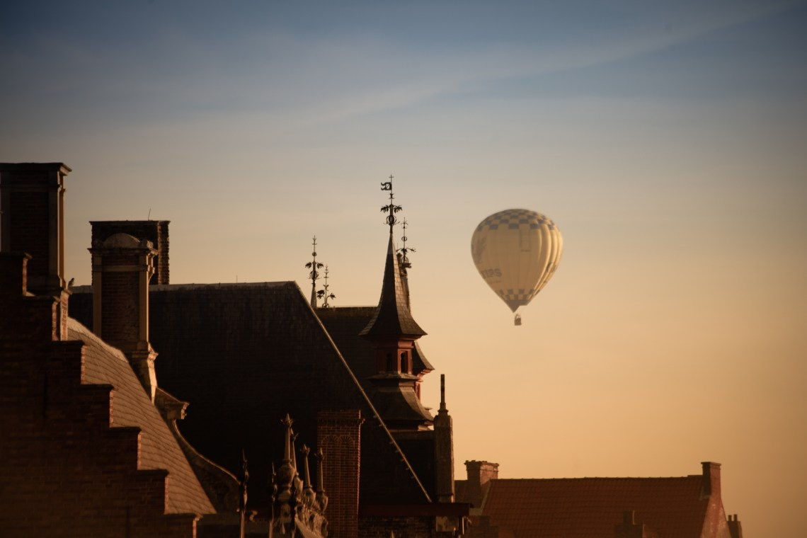 hot air balloon over brugge. by leonie wise