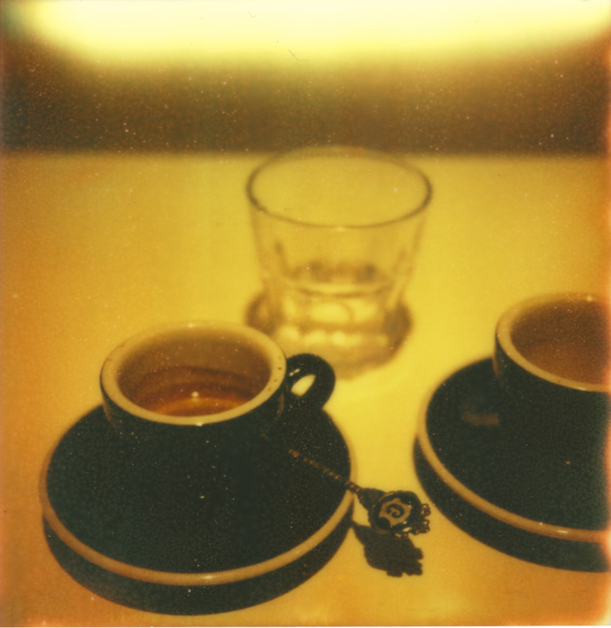 polaroid photo of two espresso cups and a water glass. copyright leonie wise
