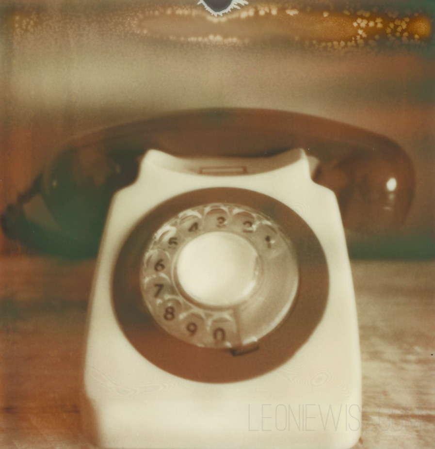 polaroid photograph of a bakelite telephone - CC-BY-NC-ND leonie wise