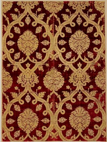Furnishing fabric, late 16th century. Panel composed of two loom widths of crimson velvet, voided and brocaded with gold and silver thread. Ottoman style, from Bursa Turkey.