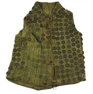 Leather war dress plated with Chinese coins and English brass buttons, 17th or 18th century. Courtesy of the Smithsonian National Museum of Natural History via Bard Graduate Center.