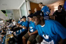 Homeless veteran Tienne Gray, U.S. Navy 1976-1982, at right, watches the game with fellow veterans along with San Jose mayor Sam Liccardo, in background, during Game 4 of the Stanley Cup Final at SAP Center in San Jose, Calif., on Monday, June 6, 2016. Destination: Home, the homeless advocacy organization, partnered with the city of San Jose to invite the veterans to the city's suite. (Jim Gensheimer/Bay Area News Group)