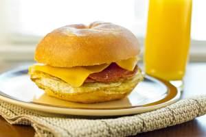 Taylor ham pork roll egg and cheese breakfast sandwich on a kaiser roll