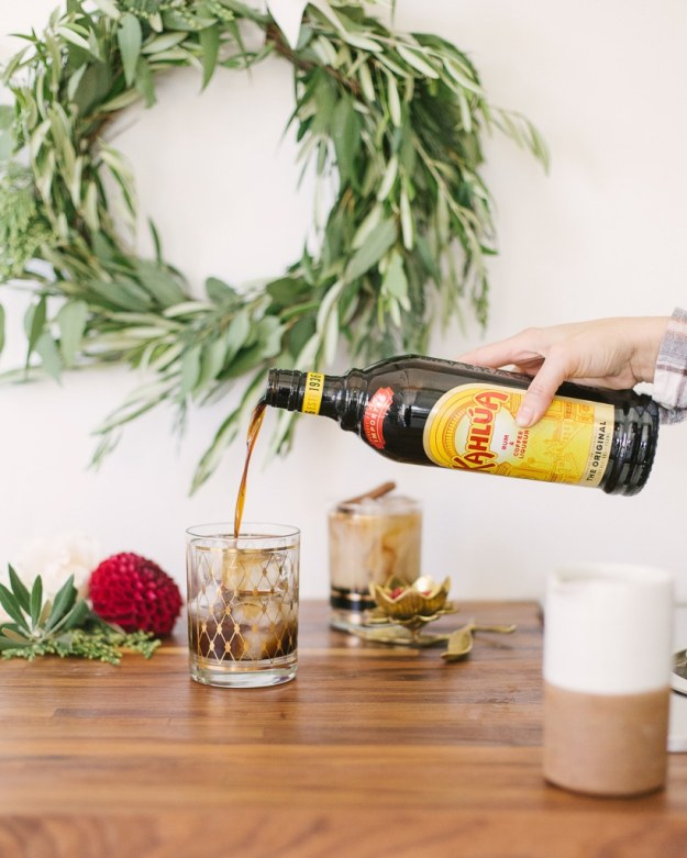 Pouring coffee liquor into Horchata White Russian