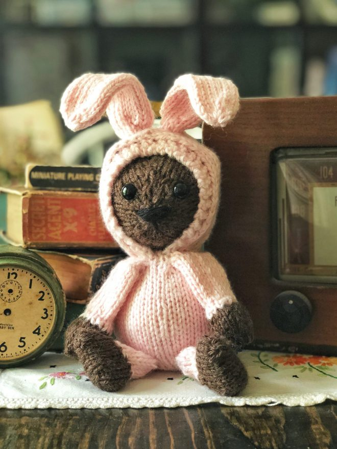Stuffed teddy bear in a pink bunny rabbit suit!