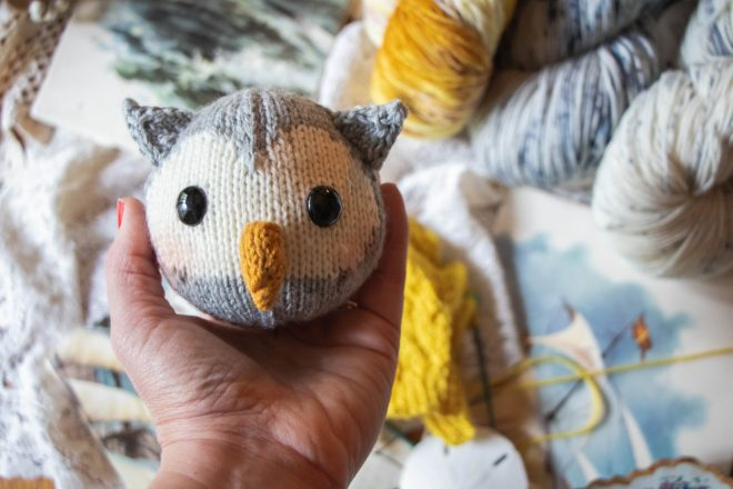 Knitted owl head and gorgeous hand dyed yarn.