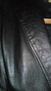 Black leather jacket detail