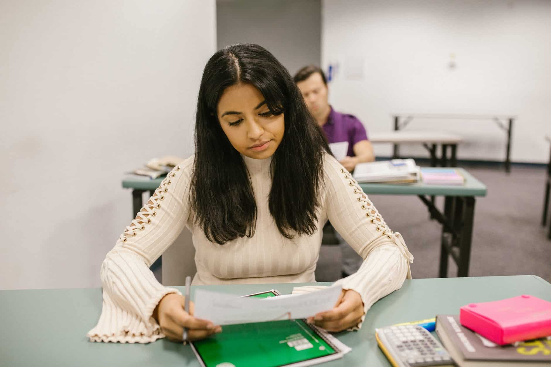 student looking at her test result
