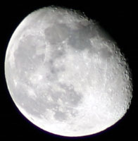 The moon on Oct 20, 2005, taken with my F5.6 300mm lens and  my Canon Digital Rebel.