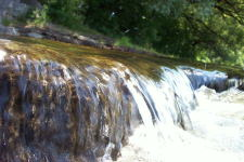 A close up view of a 18cm (6 inch) high water fall on the Rideau river, June 2002.