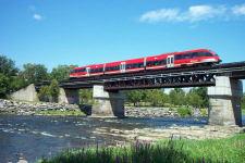 Ottawa's new spiffy O-Train crossing the Rideau River near Carleton University, June 2002.