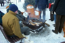 A small fire pit for people to warm up at.