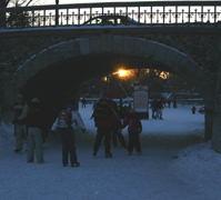 The sun setting under the Queen Elizabeth Parkway bridge into  Patterson Creek.