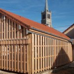 murs en bois du préau réalisé à Chemin d'Aisey par les Charpentiers montbardois à Montbard