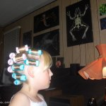 child in hair curlers