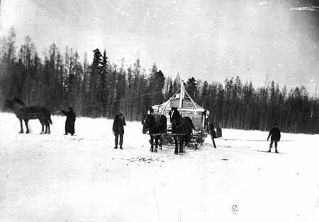 Old black and white photo of a horse team in the winter, most likely taken sometime in the 1930s. Source Unknown.
