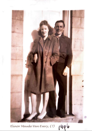 man and woman (my mother, elinor maude falls, nee van every) leaning together in a doorway. Maude is wearing winter overcoat with stripes of sunlight dappling it.