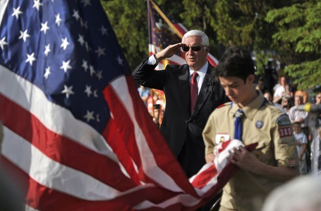 Governor Tom Corbett salutes as a Boy Scout raises the American flag while the National Anthem is played on Monday, May 26, 2014. Nabil K. Mark/Centre Daily Times / MCT