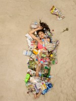 Cass surrounded by seven days of her own rubbish in Pasadena, California. (Photo by Gregg Segal/Barcroft Media)