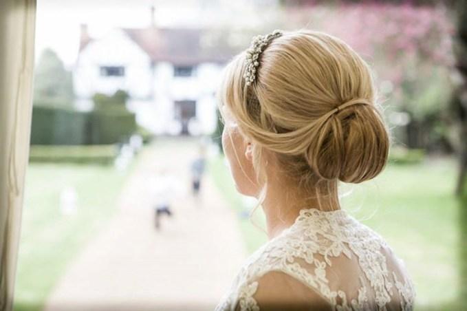 Wedding hair classy bun with tiara headband by Les Ciseaux St. Armands
