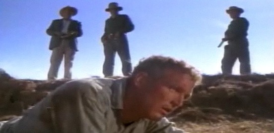 Strother Martin let's Paul Newman know of a failure to comminicate.
