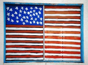 A Flag painted on a window in Tripp, South Dakota