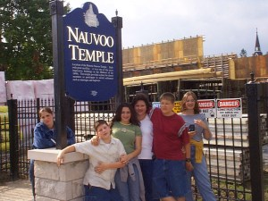 Family at the Nauvoo Temple under construction in Nauvoo, Illinois. Summer 2001