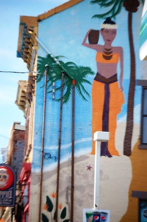 Tall mural on side of a building in Cincinnati's Northside
