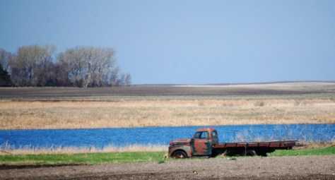 An Old Truck by a pond in North Dakota