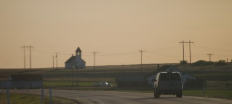 An old church building on the horizon east of Culbertson, Montana on US Hwy 2