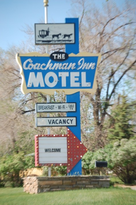 An old neon sign for the Coachman Inn