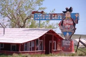 An old neon relic of the past, the Tumble Inn Lounge/Cafe, with a vintage neon look in Powder River, WY
