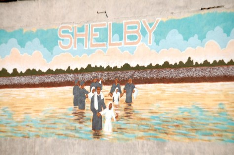 Wall mural depicting a river baptism in Shelby, MS. Its not all about the blues