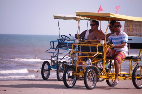 Surrey riding along the beach in Galveston