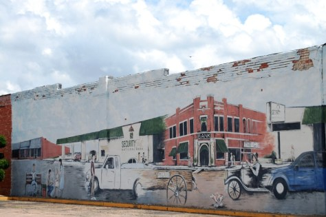 Old wall mural in Hugo depicts some of the history of the town.