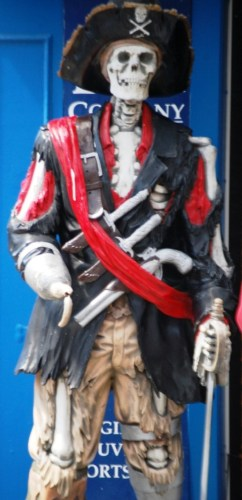 A skeleton pirate guards the entrance to a shop in Fisherman's Wharf