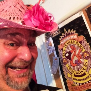 Goofing around at Carla's house with her pink flamingo hat and a few Antsy McClain posters