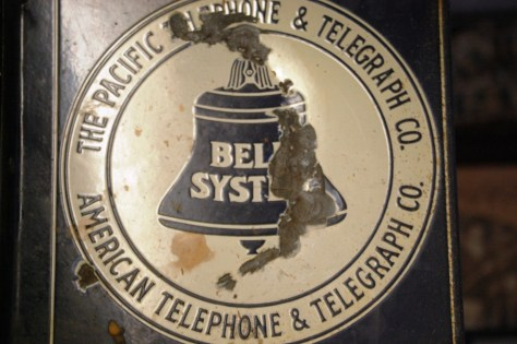 Old telephone sign in Naches Tavern