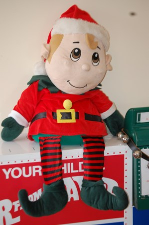 An elf guards the Santa Letter mailbox