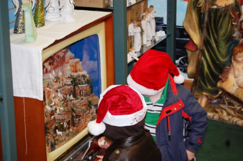 Kids fascinated by Silent Night musical diorama