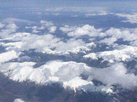 Flying over the snow-capped Rocky Mountains in Colorado, including Mt. Evans