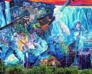 "A portion of a massive mural on the side of a shopping mall. Entitled ""History of the Niagara Peninsula"" by Heinz Gaugel"