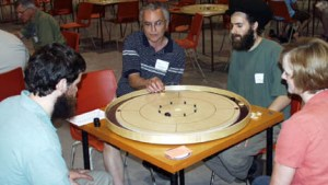 Playing Crokinole at the 2008 International Crokinole Championships in Tavistock, Ontario