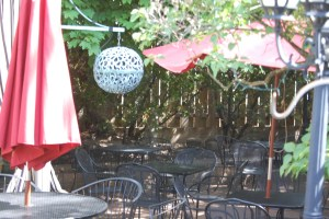 Outdoor patio seating under the decades old grapevines at Guarino's