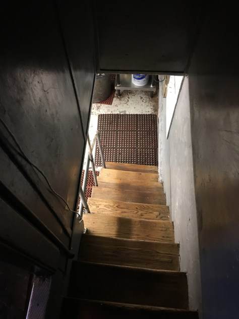 Old rustic stairway down to the decades old basement kitchen