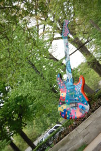 One of many colorful guitars that can be found throughout the city