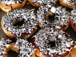 Coconut covered chocolate iced donuts