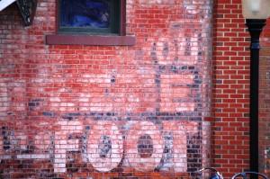 Old Brick Wall Advertisement in Pella