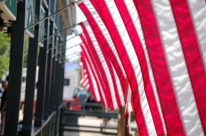 Flags hang in front of Lambert's Cafe