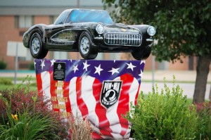 Old Corvette on pedestal at Corvette Museum in Bowling Green, Kentucky